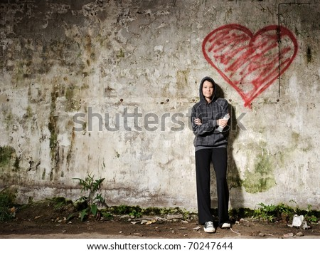 Proud graffiti girl stands with her valentine heart
