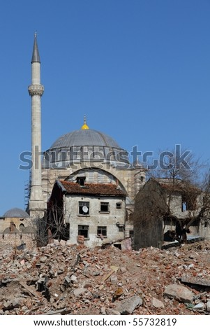 proud mosque surrounded by broken down houses and Construction waste in Istanbul, Turkey
