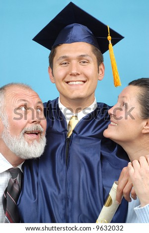 Proud parents with their graduate son - stock photo