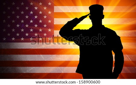 Proud saluting male army soldier on grungy american flag background (Memorial day, Veteran's day, 4th of july, Independence day)