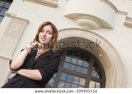 Proud Smiling Young Pretty Businesswoman Portrait Outside in Front of City Hall Building.