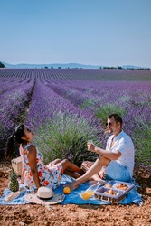 Provence, Lavender field France, Valensole Plateau, colorful field of Lavender Valensole Plateau, Provence, Southern France. Lavender field. Europe. Couple men and woman on vacation at the provence