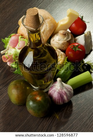 Provence Snacks and Appetizers with Vegetables, Ham, Ciabatta, Cheese and Olive Oil closeup on Dark Wood background