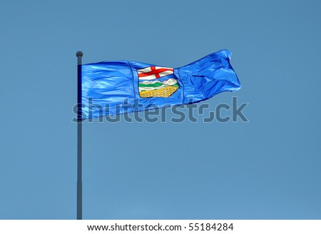 Provincial Flag for Alberta, Canada blowing in the wind illuminated by sunlight.