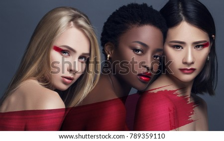 Stock Photo Provocative Make up. Gorgeous Women Face. concept of female beauty in different nationalities. perfect skin and makeup, bright facial features and deep eyes