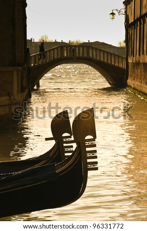Prows of two gondolas moored on Rio dei Giardinetti canal - Venice, Venezia, Italy, Europe