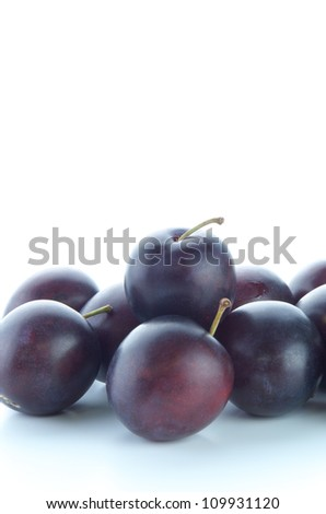 Prunes on white background