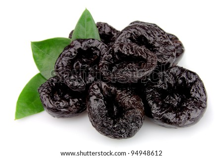 Prunes with leafs on a white background