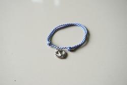 Prusik bracelet with silver anchor charm. Prusik rope bracelet blur