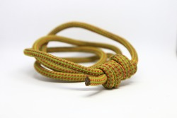 Prusik loop tied with fisherman's knots in yellow 6mm static cord.  Used for rope access, rock climbing, rescue, etc.