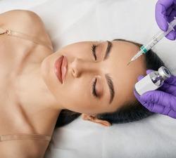 PRX-T33 peeling. PRX-T33 biorevitalization peel for woman's face at a beauty clinic. Surgery-free facial rejuvenation