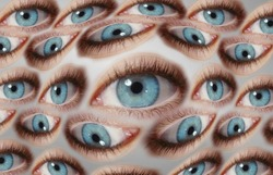 Psychedelic abstract background of distorted eye pattern with one big eye looking real eyes with blue colors splash