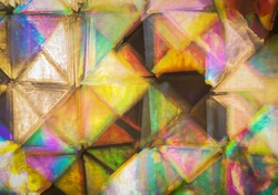 Psychedelic abstract background squared prism pattern. Trippy light exposure with swirling rainbow colors