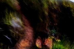 Psychedelic, hyper-realistic, vibrant multicolor image of hiker's shadow on mountain footpath pattern - abstract, motion-blurred background texture