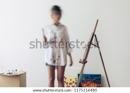 Psychedelic portrait of artist drawing picture. Photo in motion on long exposure