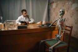 Psychiatrist and patient skeleton, mental hospital