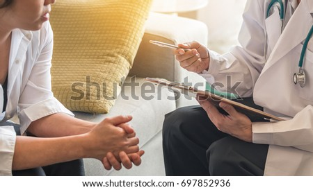 Psychiatrist or gynecologist doctor consulting and having diagnostic examination on woman patient's health depression in medical clinic or hospital exam room office