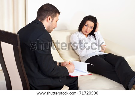 Psychiatrist talking with depressed woman patient and trying to help  her