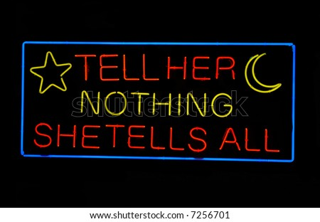 """Psychic's """"Tell Her Nothing - She Tells All"""" neon sign"""