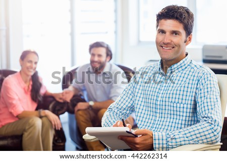 Psychologist helping a couple with relationship difficulties in office