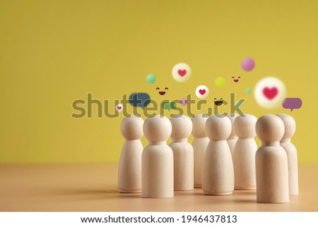 Psychology Personality Concept. Extrovert Person. person who Happy and Enjoy by Talking, Interaction, Party Often. presenting by wooden peg dolls Stock photo ©