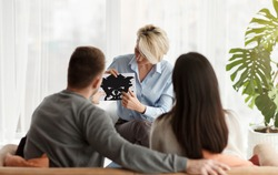 Psychology Tests. Family Psychologist Working With Couple Showing Them Rorschach Inkblot Picture During Session In Office. Selective Focus