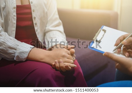 Psychotherapist works and counsels young woman, closeup on hands, toned. Сток-фото ©