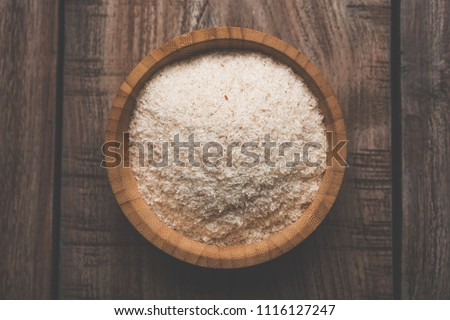 Psyllium husk or isabgol which is fiber derived from the seeds of Plantago ovata, mainly found in India. Served in a bowl over moody background. selective focus