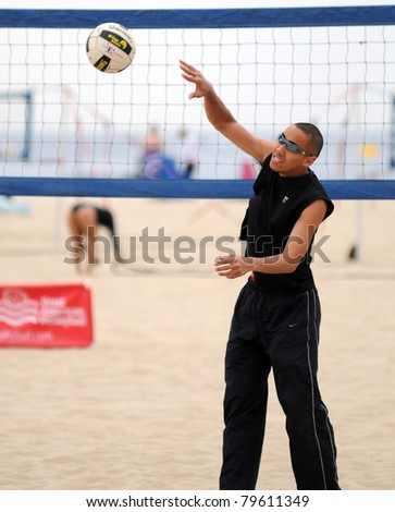 PT. PLEASANT BEACH, NJ- JUNE 4: Unidentified male beach volleyball player practices at the Great American Volleyball event on June 4, 2011 in Pt. Pleasant Beach, NJ.