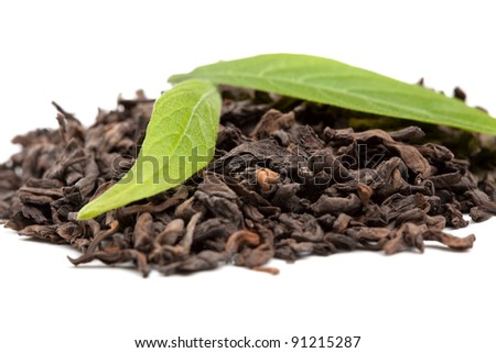 Pu-erh tea and fresh tea leaves