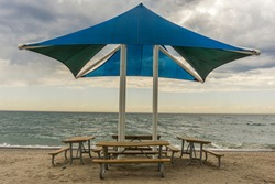 Public beach shelter and benches at Pickering waterfront, Ontario, Canada
