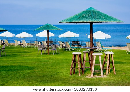 Public beach with sunbeds in the morning. Paphos. Cyprus