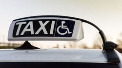 Public car equipped for assistance and transportation for handicapped person