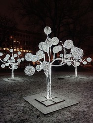 Public Christmas lighting. Light performance in the public park. Street adornment.