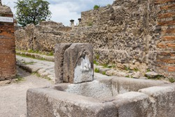 Public drinking water source. Archaeological ruins of the ancient Roman city, Pompeii, Italy.