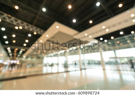Public event exhibition hall, blurred bokeh defocused background, business trade show or modern interior architecture concept. #609898724