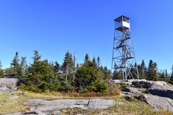 Public Firetower on top of summit in Adirondack Mountains in Autumn