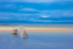 Public foot bridge submerged in sea water. The bridge to no where, dunbar, Scotland, uk.
