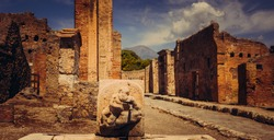 public fountain with hercules that kills the lion in the streets of Pompeii, Pompeii was destroyed, during a catastrophic eruption of the volcano Mount Vesuvius spanning two days in 79 AD.