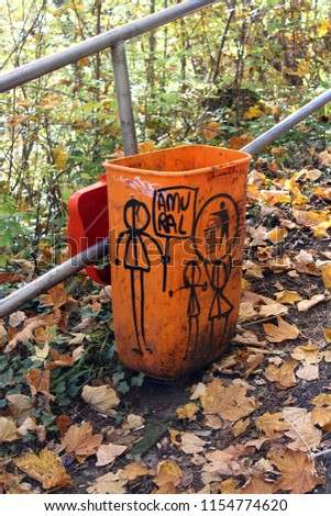Public garbage can in Brasov drawn with Amural festival drawns in autumn background #1154774620