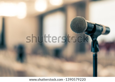 Public hearing with microphone voice speaker in business seminar, speech presentation, town hall meeting, lecture hall or conference room in corporate or community event for host