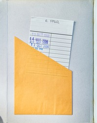 Public Library Book opened to the first page showing aged textured cover with a Check Out or due date card.