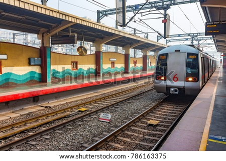 Public Metro arriving at Shastri Park station in New Delhi, India, Asia. More than 5 lakhs passengers travel from Delhi Metro. It is the pride of Delhi & India as well. Metro Rail Corporation in India