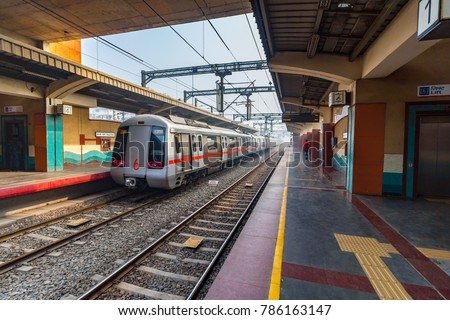 Public Metro departing from Shastri Park station in New Delhi, India, Asia. More than 5 lakhs passengers travel from Delhi Metro. It is the pride of Delhi & India as well. Delhi Metro Rail Corporation