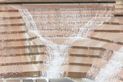 Public park in Fort Worth, Texas, USA. Water Gardens with rushing water over the concrete structures, cascading