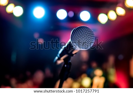 Public performance on stage Microphone on stage against a background of auditorium. Shallow depth of field. Public performance on stage. #1017257791