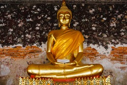 Public place Buddha statue with thai art architecture at Wat Suthat temple. This is a Buddhist temple in Bangkok .