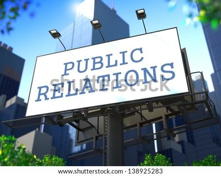 """Public Relations Concept. Slogan""""Public Relations"""" on Billboard on the Background of a Modern Business Center."""