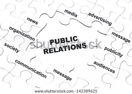 Public relations white puzzle pieces assembled