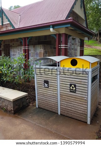 Public rubbish bins for recyclables and non-recyclables.